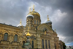 Beautiful golden cupolas of the Temple Of The Assumption church Vasilyevsky Island, St Petersburg, Russia.