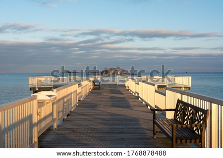 Beautiful golden hour light on the long pier and the Long Island Sound at Calf Pasture Beach in Norwalk, Connecticut USA Сток-фото ©
