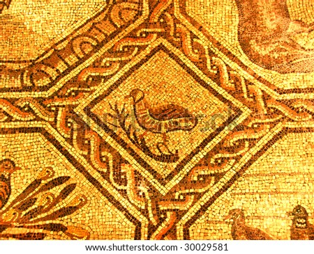 Beautiful golden roman mosaic of what appears to be a partrige perched on a branch