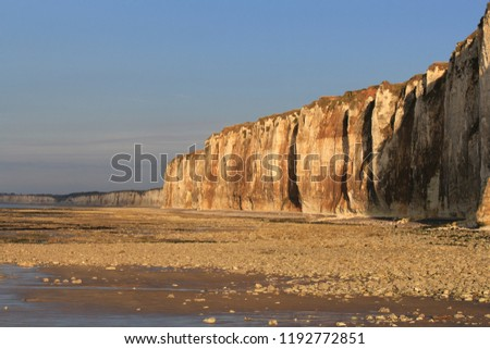 beautiful golden sunrays at the cliffs of the alabaster coast at a wonderful evening in summer #1192772851
