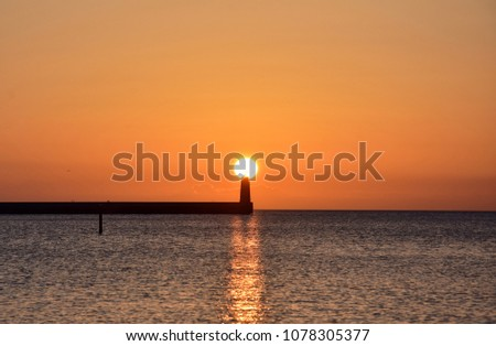 beautiful golden sunrise over the baltic sea in gdynia, poland #1078305377