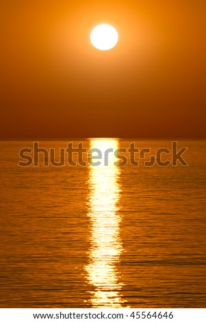 Beautiful golden sunrise over the water