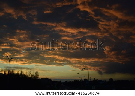 Beautiful golden sunset in the city with red clouds #415250674