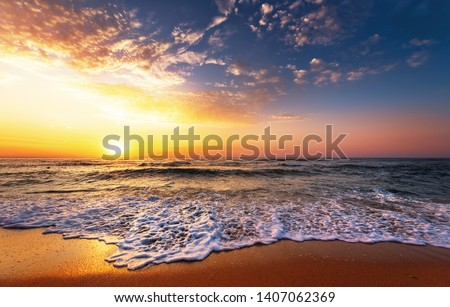 Beautiful golden sunset over the beach. #1407062369