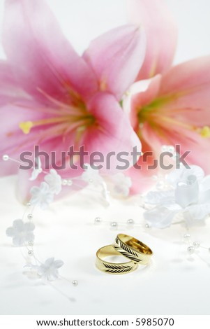 stock photo Beautiful golden wedding rings with flowers