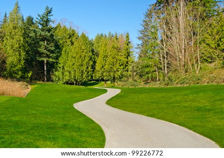 Beautiful golf course with gorgeous green and cart path. - Shutterstock ID 99226772
