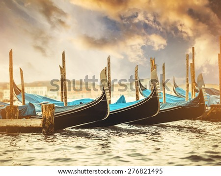 beautiful gondolas in a canal in Venice at sunset, Italy