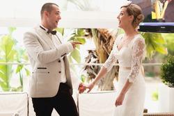 beautiful gorgeous blonde bride and stylish groom celebrating wedding on the restaurant terrace
