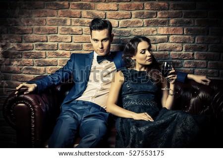 Beautiful gorgeous couple in elegant evening dresses. Fashion, glamour.