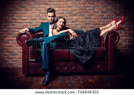 Beautiful gorgeous couple in elegant evening dresses. Fashion, glamour.