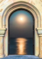 Beautiful gothic medieval arched stone window. Magnificent majestic view from the window. Full moon and lunar path on the smooth surface of the sea