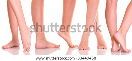 Beautiful graceful female feet, isolated on a white background, please see some of my other parts of a body image