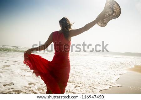 Beautiful graceful young woman enjoying the sea - stock photo