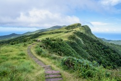 Beautiful grassland, prairie in Taoyuan Valley, Caoling Mountain Trail passes over the peak of Mt. Wankengtou in Taiwan.