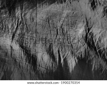 Beautiful gray fabric - taffeta, gently folded in waves. Crumpled material that looks like silk or brocade. Fabric for sewing clothes and curtains. Monochrome image Foto d'archivio ©