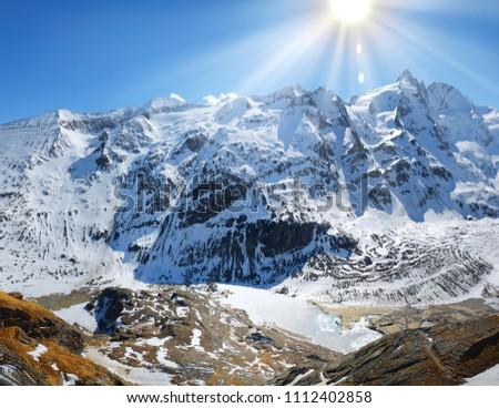 Beautiful great north Alpen trip mountainside vista panorama of plateau. Light clouds on bright blue heaven above tall crag. Rural scenic top view with space for text. freeze pond in rocky ravine