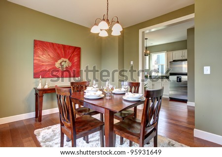 Beautiful green dining room with kitchen view.