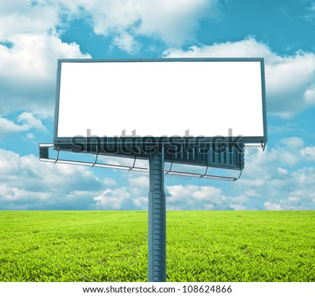 Beautiful green field with empty billboard