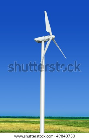 Beautiful green meadow with wind turbine generating electricity