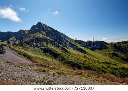 Beautiful green mountain landscape with bright blue sky. North Caucasus.