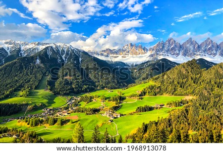Beautiful green mountain valley in the Alps. Alpine mountains. Mountain valley landscape