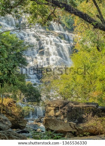 Beautiful green trees with waterfall flowing background, Mae Ya Waterfall, Chom Thong District, Chiang Mai, Thailand. #1365536330