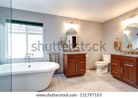 Beautiful grey new luxury modern bathroom interior with two separate sinks.