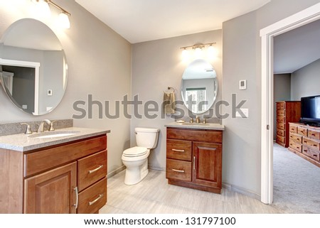 Beautiful grey new modern bathroom interior with two separate sinks.