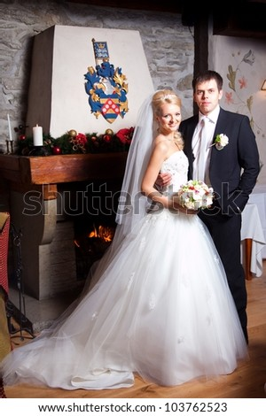 beautiful groom and bride in interior on wedding day