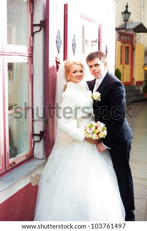 beautiful groom and the bride on the street of old Tallinn