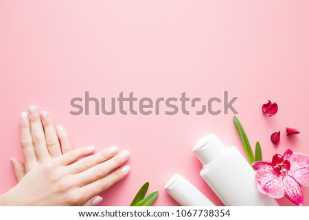 Beautiful, groomed woman's hands. Moisturizing cream bottles for clean, perfect and soft skin. Beauty concept. Mock up for special offers. Copy space. Empty place for text or logo on pink background. #1067738354