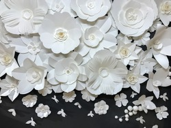 Beautiful Group of Variety Style Handmade Quilling White Floral Pattern with Small Butterfly made from Paper on Black Fabric Wall Background used as Template of Flowers Interior Vintage Retro Style