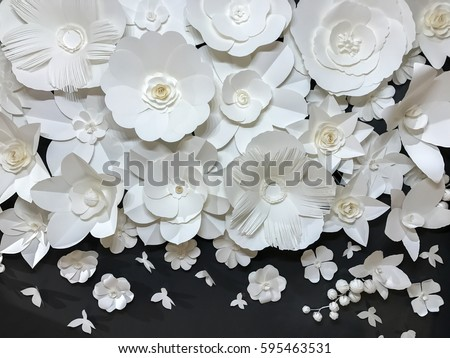 Beautiful Group of Variety Style Handmade Quilling White Floral Pattern with Small Butterfly made from Paper on Black Fabric Wall Background used as Template or Backdrop Interior Vintage Retro Style #595463531