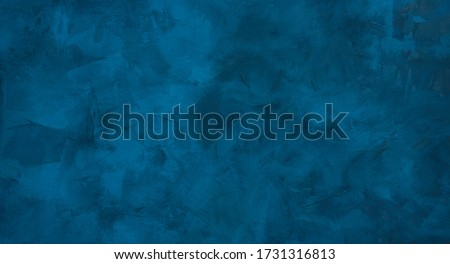 Beautiful grunge navy blue stucco wall background. Panoramic abstract decorative dark background. Wide angle rough stylized texture wallpaper with copy space for design.