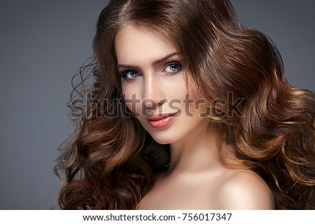 Beautiful hair woman beauty skin portrait over dark background. Long beautiful healthy hair model girl stock image. Studio shot. #756017347