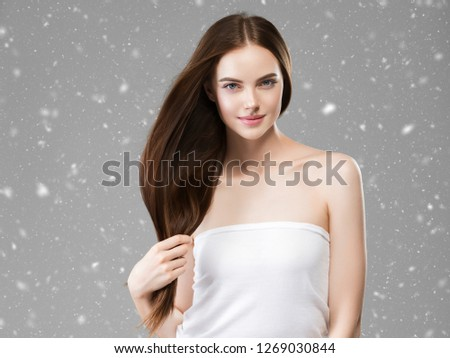 Beautiful hair woman beauty snow winter background concept