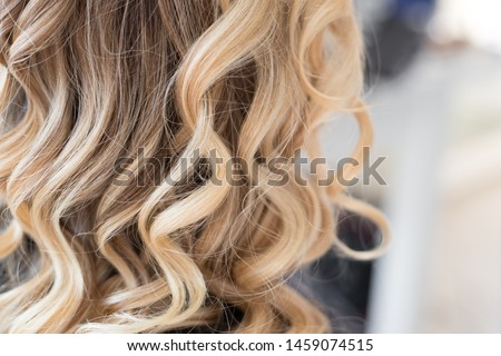 Beautiful hairstyle of young woman after hair wrapping and styling Photo stock ©