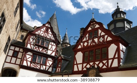 Beautiful half-timbered architecture in the courtyard of Schloss Buerresheim (Burresheim Castle), located in the Eifel area in Rhineland-Palatinate, Germany, near the town of St. Johann (Mayen).