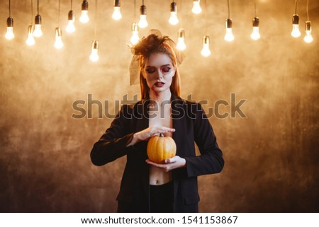 Beautiful Halloween Vampire Woman portrait. Mysterious Model girl with Halloween make up