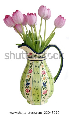 beautiful hand made vase with pink tulips against white background