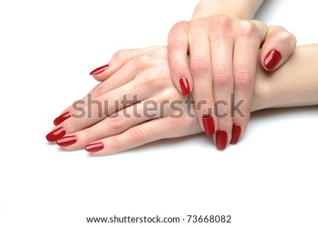 Beautiful hand with perfect nail red manicure isolated on white background