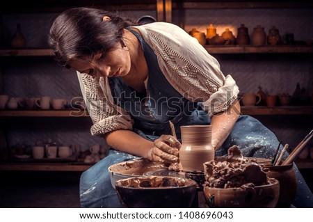 Beautiful handicraftsman master making ceramic pot on the pottery wheel . Handcraft. Stock fotó ©