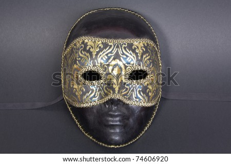 beautiful handmade venetian mask on dark blue background - stock photo