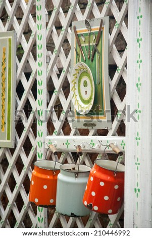 beautiful handmade works hanging on wooden fence