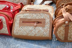 Beautiful handmade Woven bags are displayed in a shop for sale in blurred background. Indian handicraft