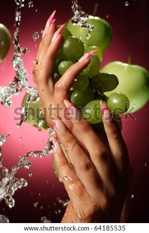 beautiful hands and nails on pink background