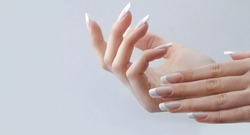 beautiful hands with manicured french nails manicure. nail extension