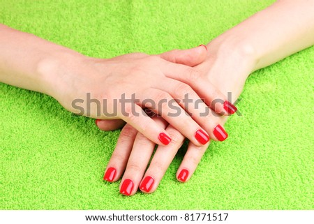 Beautiful hands with red manicure