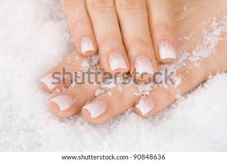 beautiful hands with snow closeup