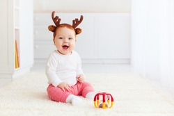 beautiful happy baby deer playing with toy at home